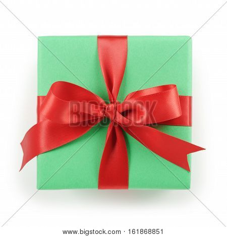 green paper gift box with red ribbon bow top view on white background, isolated with shadow