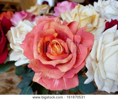 colorful orange handmade fake rose flower closeup