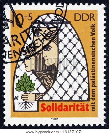 GERMANY - CIRCA 1982: a stamp printed in Germany shows Palestinian Family and Tree of Life Palestinian Solidarity circa 1982