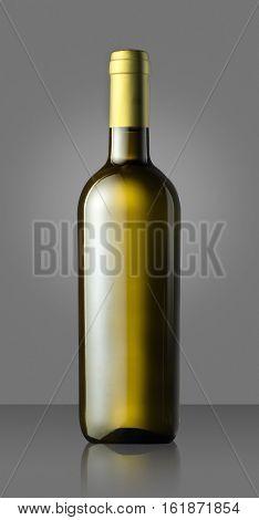 Single Unlabelled Green White Wine Bottle On Grey