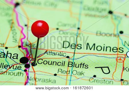 Council Bluffs pinned on a map of Iowa, USA