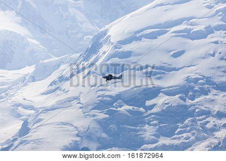 Small plane and Mt Blanc. Chamonix Auvergne-Rhone-Alpes France.