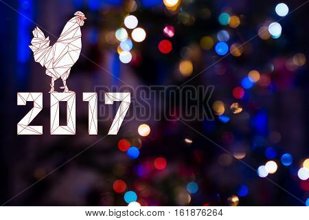 2017 with Cock on festive Christmas background with bokeh from New-year tree lights glowing. Rooster is symbol of New 2017 year of red fiery cock. Blurred colorful circles on holiday background