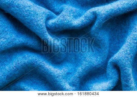Close Up Of Blue Crumpled Woolen Cloth. Top View. Woolen Cloth.