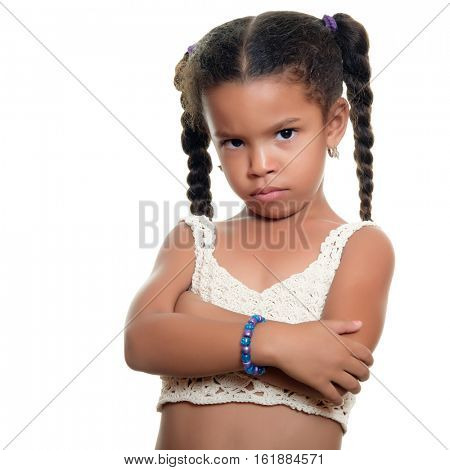 Angry african american small girl isolated on a white background