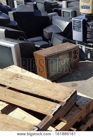 Old televisions, computers, and other electronics and devices await the recycle company at a local dump.