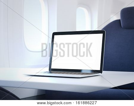 Laptop with blank screen on the table in a luxury airplane cabin. 3d rendering