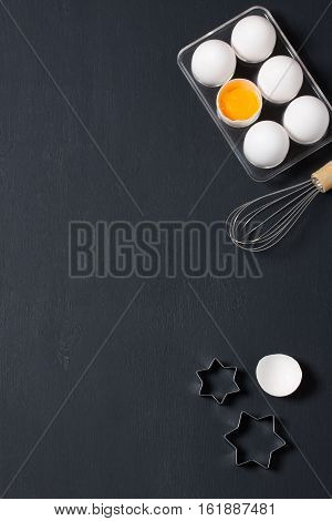 Baking Background With Eggs, Whisk And Star Cookie Cutters