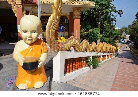 PATTAYA THAILAND - 22 NOV 2016: Buddha statue Buddhist temple on Phra Tmanak Hill Khao Phra Bat Temple in Pattaya Thailand