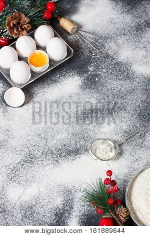 Christmas Baking Background With Eggs, Whisk And Floor