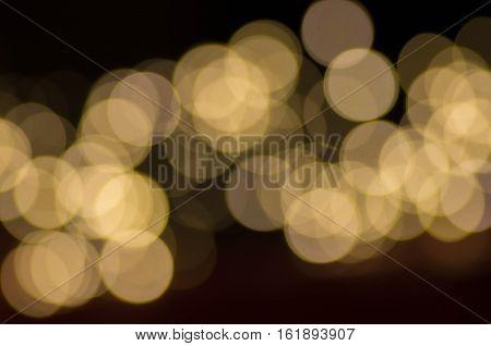 Dark Gold Festive blur background. Christmas blurry boke lights