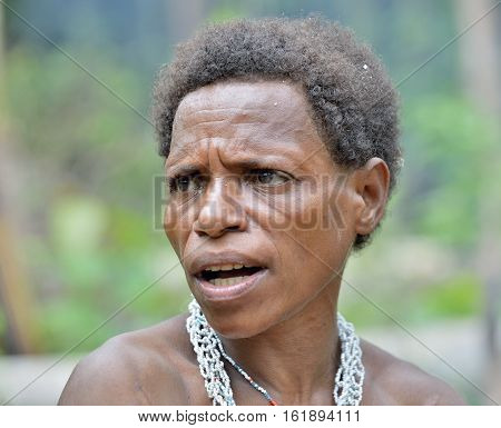 Wild Jungle, Irian Jaya, New Guinea, Indonesia - May 19, 2016: Portrait Of Papuan Woman From Korowai