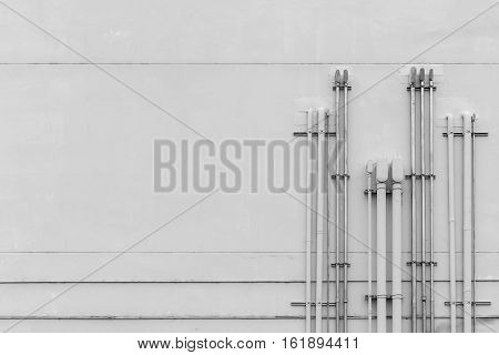 electric pipe on concrete wall industrial background black and white tone