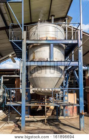 Vertical photo in color of an industrial autoclave in a factory to cook agave for tequila
