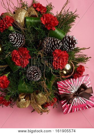 Christmas decoraion on pink background with present box