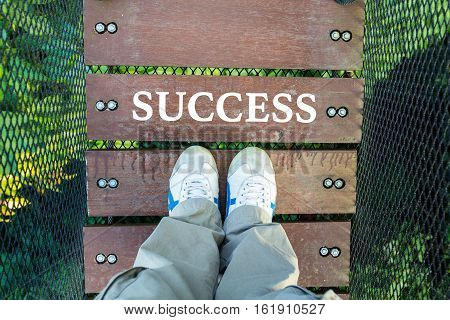 Success And Man Leg On Wood Canopy Walk Way