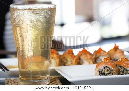 Iced tea with Japanese sushi in the restaurant