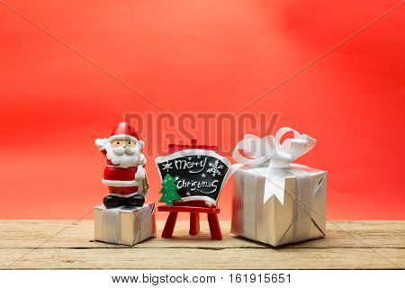 Gift boxes and Santa Claus on wood plate