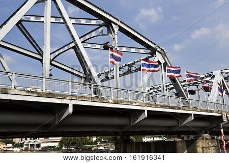 Krung Thon Bridge is a bridge of 6 spans over the Chao Phraya River in Bangkok in Thailand. It consists of a steel superstructure resting on concrete piers and was built between 1955 and 1957.