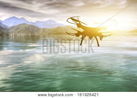 silhouette of drone flight over the lake