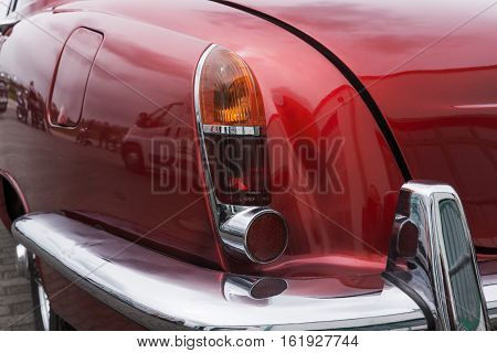 Closeup of red old retro car backlight