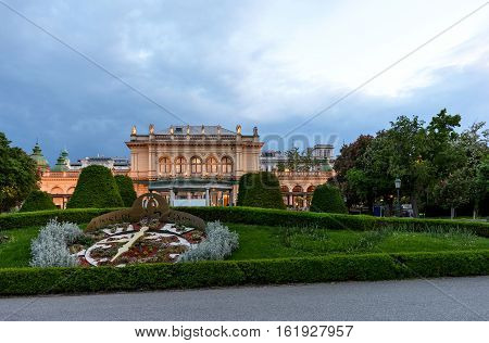 AUSTRIA, VIENNA - MAY 14, 2016: View on real big clock and buildings in stadpark