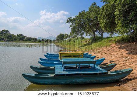 Fishing boat on Sri-Lanka. Aboriginal fishermen catamaran on the sandy shores