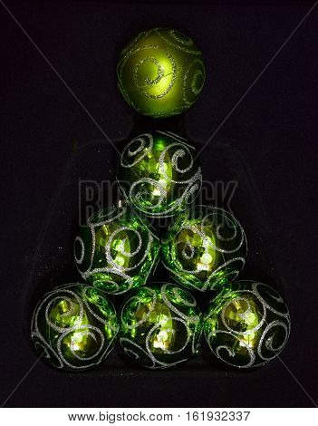 decorations for Christmas trees pyramide glass balls on a black background