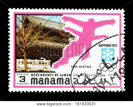 MANAMA - CIRCA 1971 : Cancelled postage stamp printed by Manama, that shows Ice skating.