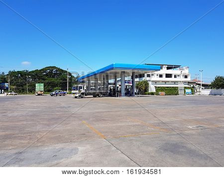 CHIANG RAI THAILAND - NOVEMBER 28: PTT gas station with customers refueling on November 28 2016 in Chiang rai Thailand.