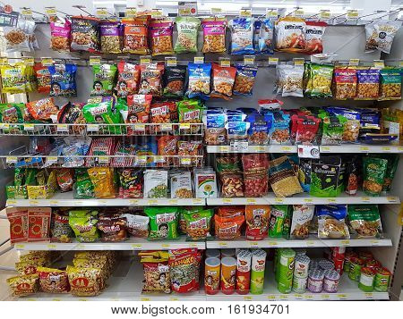 CHIANG RAI, THAILAND - NOVEMBER 26: various brand of dry peas in packaging for sale on supermarket stand or shelf in Seven Eleven on November 26, 2016 in Chiang rai, Thailand.