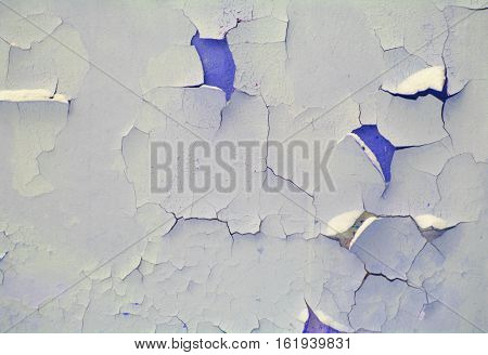 old blue cracked damaged plaster wall background