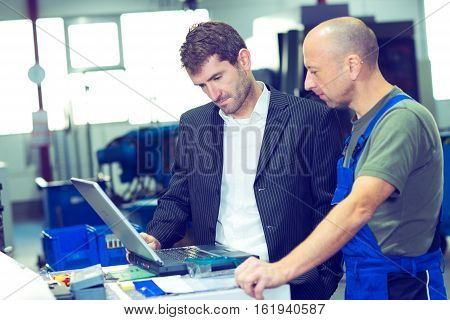 Boss And Worker On Work Bench