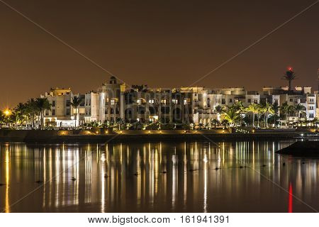 Amazing night lights in Sultanate Oman Souly Bay harbour and Hotels Oceanside