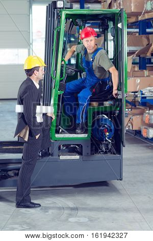 Boss And Worker In Lift Truck