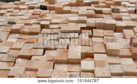 Pattern of unevenly protruding rectangular wooden pine sticks.