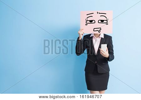 business woman take tired billboard and use smart phone isolated blue background