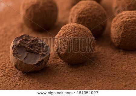Close Up Of Group Of Appetizing Black Chocolate Truffles Covered In Cocoa Dust. Shallow Depth Of Fie