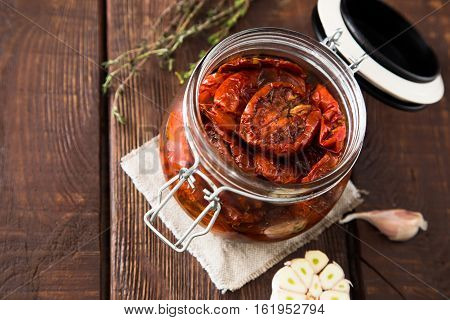 Sun Dried Tomatoes With Herbs And Sea Salt In Olive Oil In A Glass Jar