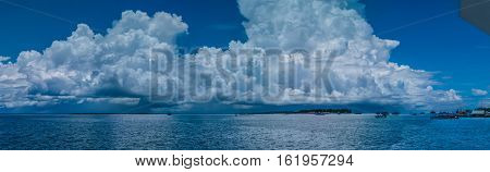 Huge White Clouds above Port in Waisai, Waigeo, Raja Ampat, West Papua, Indonesia. Banner