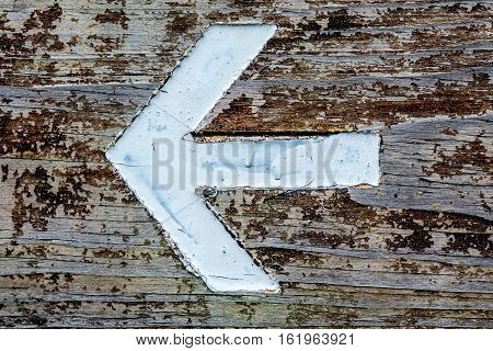 arrow sign on wood background and texture