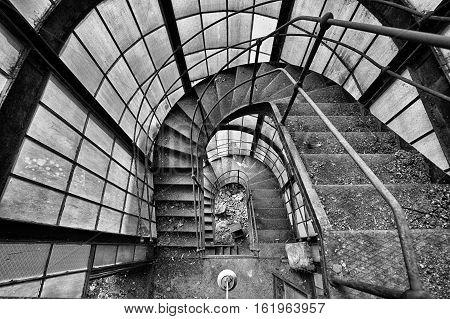 Dark Stairway with big windows going way down