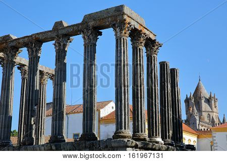 EVORA, PORTUGAL:  Roman ruins of Diana's Temple and The Cathedral in the background