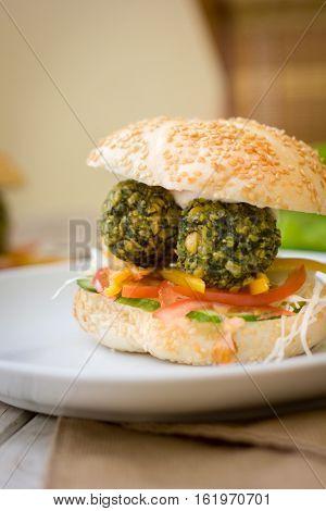 Falafel Burger. Nice Vegetarian Burger With Fresh Vegetables And Falafel