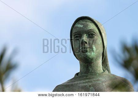 Detail of a bronze statue of the Virgin Mary in Portofino village Genova Liguria Italy