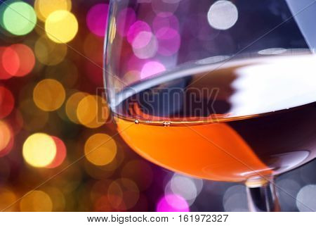 Cognac glass on a color iluminated background