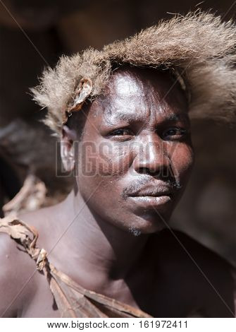 AFRICA, TANZANIA, MAY, 10, 2016 - Сloseup portrait tribesman of the hadza tribe, disappearing ethnic group in Tanzania, Africa
