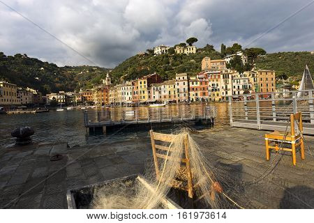 The village of Portofino with the colorful houses and the pier with fishing nets. Genova Liguria Italy