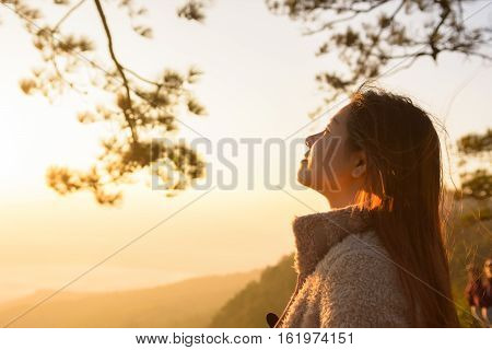 closeup woman face feeling fresh with sunrise in the morning