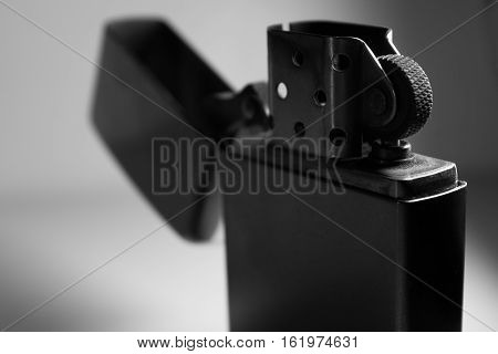 Metal lighter on a white background close up